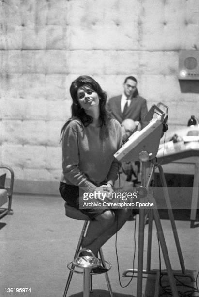 Italian actress Sophia Loren during 'El Cid' dubbing smoking a cigarette Rome 1961