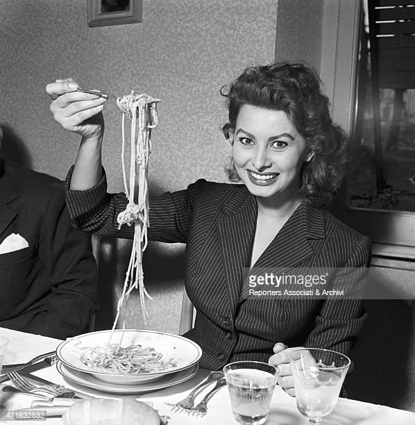 Italian actress Sophia Loren eating spaghetti in a restaurant Italy 1953