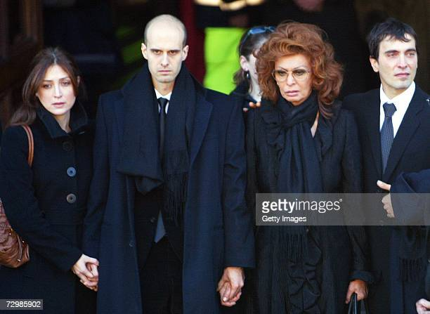 Italian actress Sophia Loren her sons Carlo Jr and Eodardo with his girlfriend leave San Martin church at the end of the funeral of former Italian...