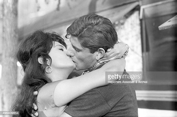 Italian actress Sophia Loren kissing Italian actor Luigi Giuliani in the episode La Riffa from the film Boccaccio '70 1961