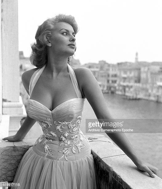 Italian actress Sophia Loren portayed standing on a terrace on the Canal Grande wearing a white embroidered dress Venice 1955