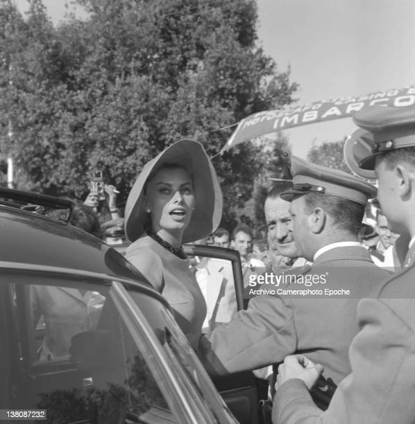 Italian actress Sophia Loren portrayed while getting out of a car wearing a wide brimmed hat Lido Venice 1958