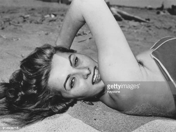 Italian actress Sophia Loren relaxes on a beach in Italy June 1954