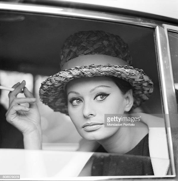 Italian actress Sophia Loren smoking in a car 1960s