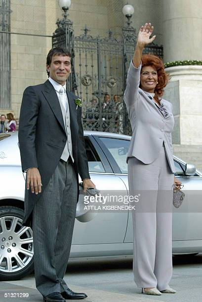 Italian actress Sophia Loren stands with her son Carlo Ponti as they wait to enter the Basilica in Budapest for the wedding of her son with Andrea...
