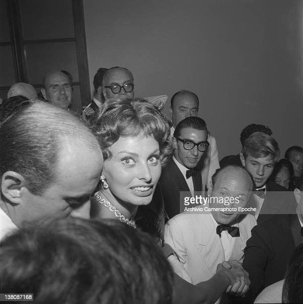 Italian actress Sophia Loren surrounded by the crowd atthe Venice Movie Festival 1958