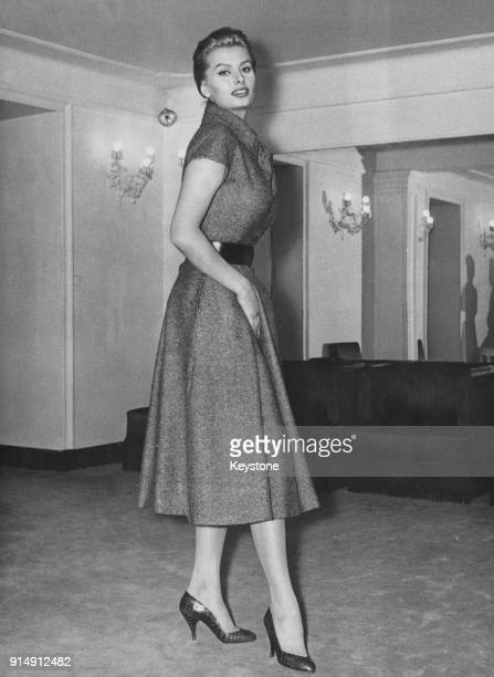 Italian actress Sophia Loren tries on a Christian Dior 'New Line' dress made by Battilocchi of Rome in a store in Rome Italy 6th February 1956