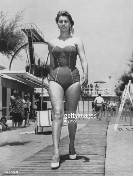 Italian actress Sophia Loren wearing a onepiece swimsuit to the beach circa 1956