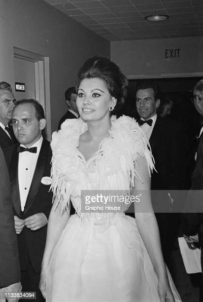 Italian actress Sophia Loren, wearing with evening gown with feather collar, backstage at the 35th Academy Awards, Santa Monica Civic Auditorium, Los...