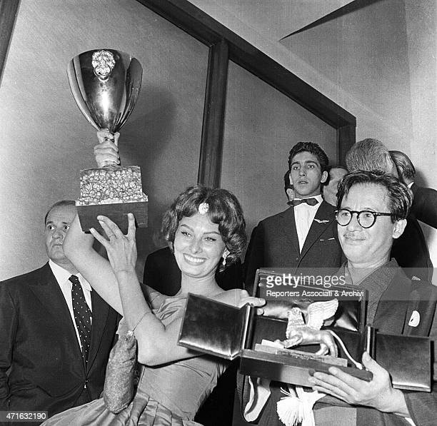 Italian actress Sophia Loren winner of the Volpi Cup for Best Actress for The Black Orchid and Japanese director Hiroshi Inagaki winner of the Golden...