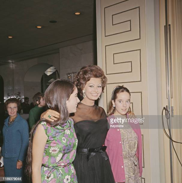 Italian actress Sophia Loren with Charlie Chaplin's daughters Victoria and Josephine at the Savoy Hotel in London England for a press conference on...