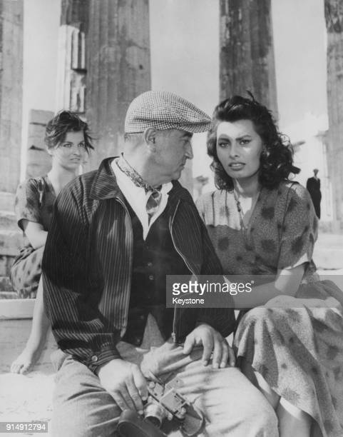 Italian actress Sophia Loren with director Jean Negulesco on the set of the film 'Boy on a Dolphin' at the Acropolis in Athens Greece 12th November...
