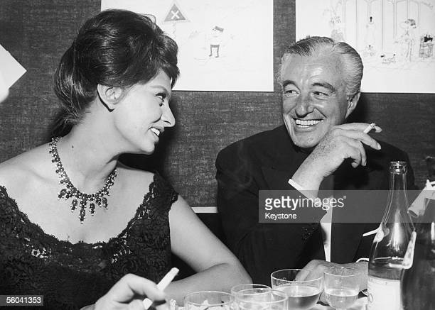 Italian actress Sophia Loren with her director Vittorio de Sica during a press conference in Milan following the first screening of their latest film...