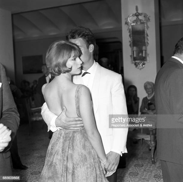 Italian actress Stefania Sandrelli and French actor Jacques Charrier dancing during a party on the ship Regina Isabella II 1965