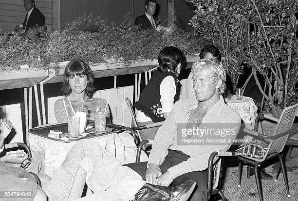 Italian actress Stefania Sandrelli and her husband Nicky Pende sitting in an outdoor café Rome 1973
