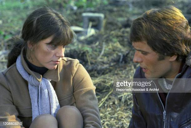 "Italian actress Stefania Sandrelli and Italian actor Giuliano Gemma on the set of the film ""Somewhere Beyond Love"". They're sitting together and..."