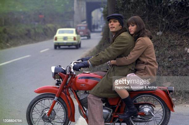 "Italian actress Stefania Sandrelli and Italian actor Giuliano Gemma on the set of the film ""Somewhere Beyond Love"". They're riding together a..."