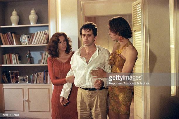 Italian actress Stefania Sandrelli and Italian actor Massimo Bellinzoni as a transvestite holding Italian actor Massimo Wertmueller in the film What...