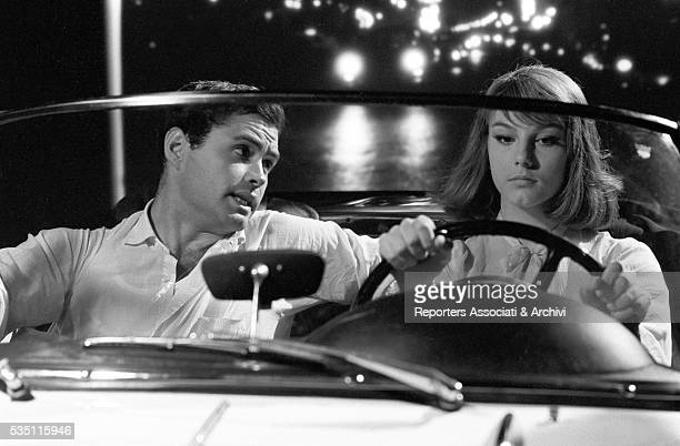 Italian actress Stefania Sandrelli and Spanish actor Angel Aranda sitting in the car in the film La bella di Lodi 25th November 1962