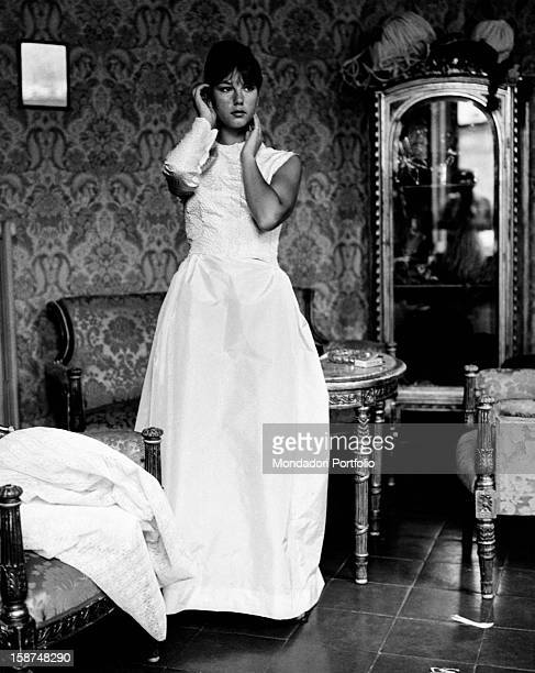 Italian actress Stefania Sandrelli is in a Roman tailor's shop while she is trying on the bridal gown she will wear in the movie Seduced and...