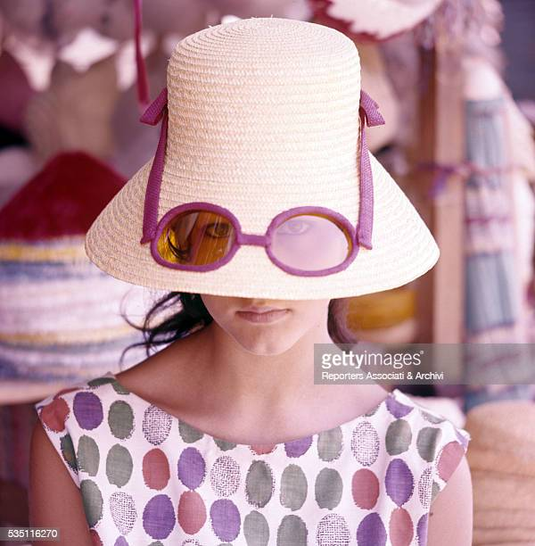 Italian actress Stefania Sandrelli wearing a bizarre hat while spending holidays somewhere in Versilia Italy 1960