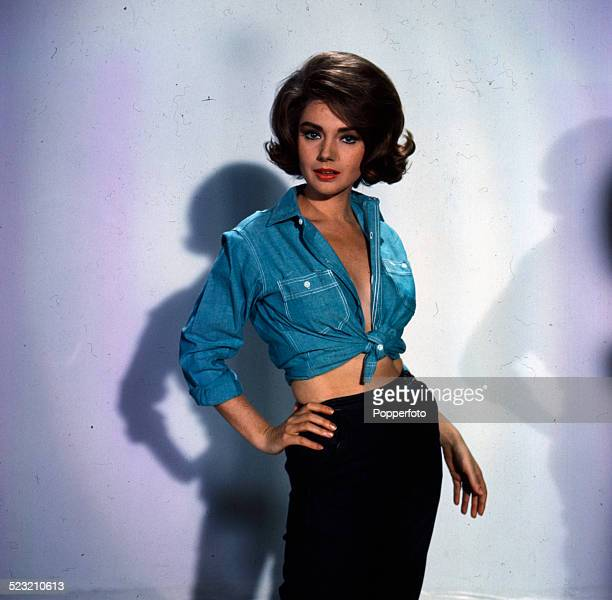Italian actress Sylva Koscina posed wearing a blue chambray style shirt in London in 1963