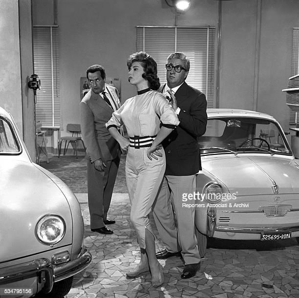 Italian actress Sylva Koscina posing with actor brothers Memmo and Mario Carotenuto with an Autobianchi Bianchina Italy 196o