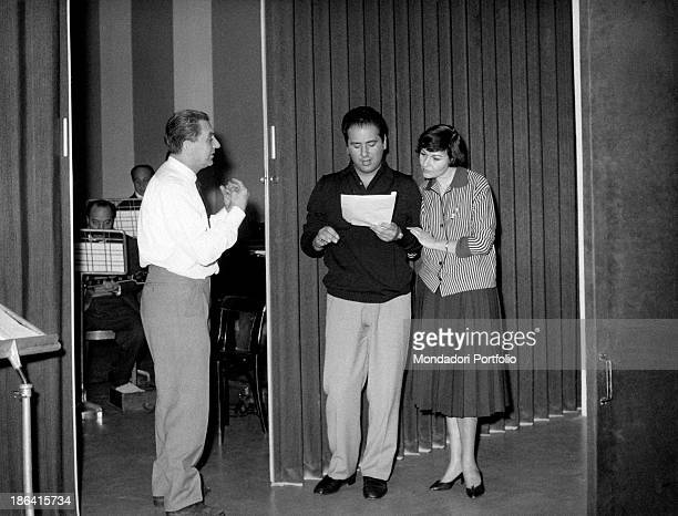 Italian actress Tatiana Farnese getting ready to sing following the directions of maestro Beppe Mojetta during the recording of a radio broadcast...
