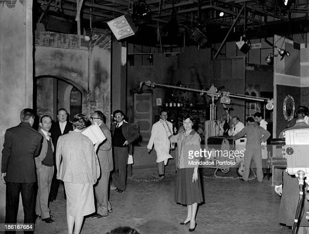 Italian actress Tatiana Farnese in the TV studio number two showing the scenary set for the TV series Il romanzo di un maestro Rome 1959