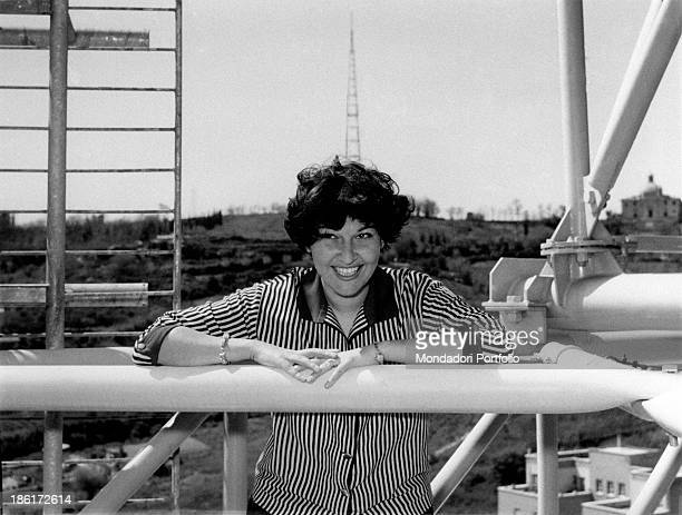 Italian actress Tatiana Farnese leaning on one of the pylons of the broadcasting horn antennas Rome 1959