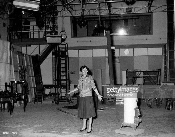 Italian actress Tatiana Farnese showing the TV studio number four temporarily used as warehouse Rome 1959