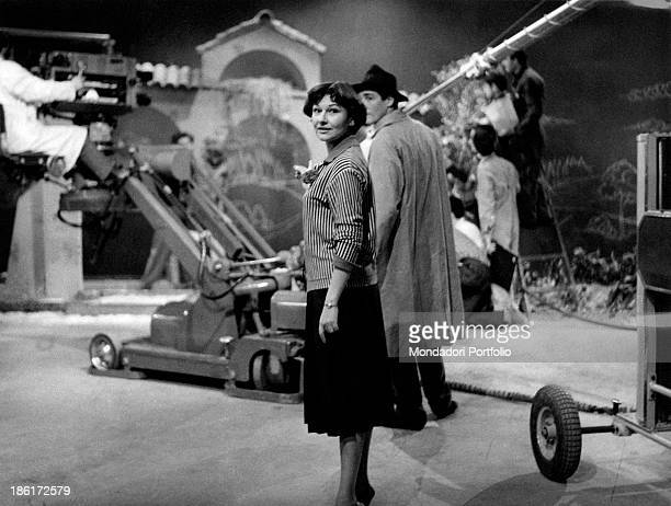 Italian actress Tatiana Farnese taking part in the shooting of the TV broadcast Il mattatore Behind her Italian actor Vittorio Gassman gets ready to...