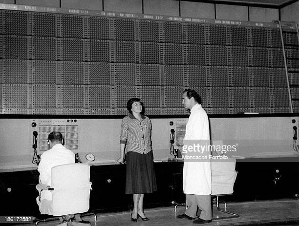Italian actress Tatiana Farnese talking with a technician in front of the general control panel Tatiana Farnese collaborates with the revue company...