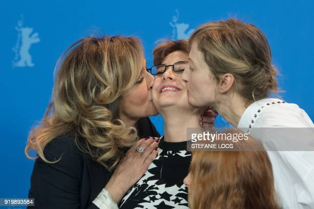 TOPSHOT Italian actress Valeria Golino and Italian actress Alba Rohrwacher kiss Italian director Laura Bispuri during a photocall for the film...