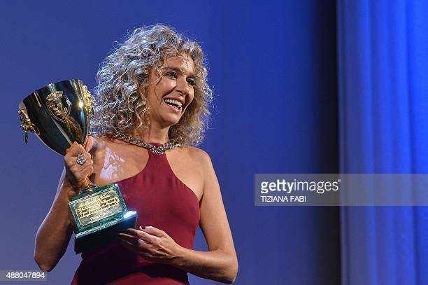 Italian actress Valeria Golino holds the Volpi Cup for Best Actress in the film 'Per Amor Vostro' during the awards ceremony on the closing day of...