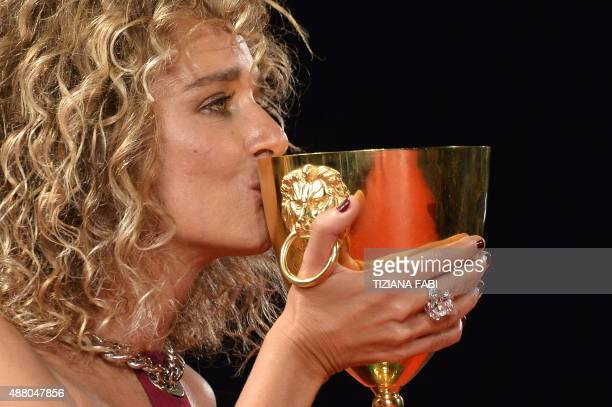Italian actress Valeria Golino kisses the Volpi Cup for Best Actress in the film 'Per Amor Vostro' after the awards ceremony on the closing day of...