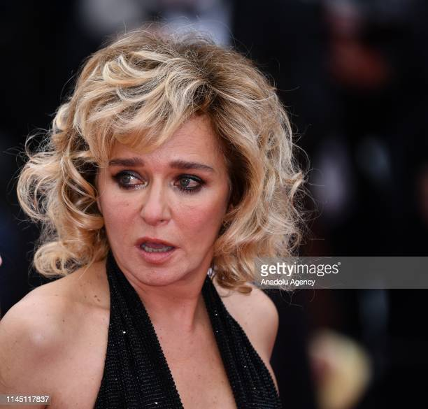 Italian actress Valeria Golino leaves after the screening of 'Portrait de la jeune fille en feu' at the 72nd annual Cannes Film Festival in Cannes...