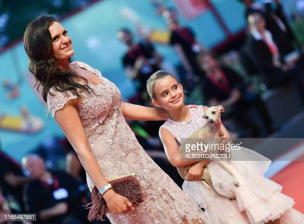 Italian actress Veronica Berti and her daughter Virginia Bocelli arrive for the screening of the film The Laundromat on September 1 2019 presented in...