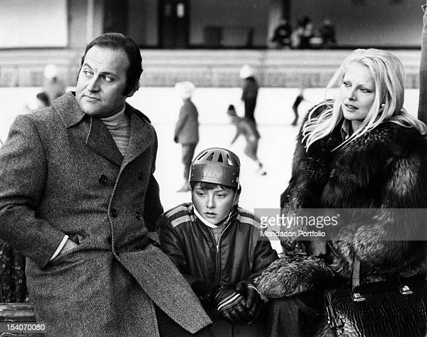 Italian actress Virna Lisi having a rest with her husband Franco Pesci and her son Corrado Cortina d'Ampezzo 1973