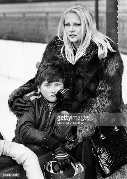 Italian actress Virna Lisi hugging her son Corrado. Cortina d'Ampezzo, 1973