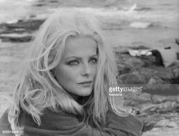Italian actress Virna Lisi on a beach in Augusta Sicily to film a scene for the Italian comedy 'Meglio Vedova' 15th November 1967