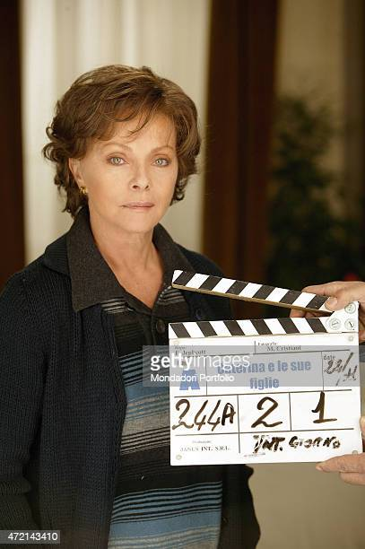 Italian actress Virna Lisi posing behind the clapper board on the set of the TV series Caterina e le sue figlie 2004