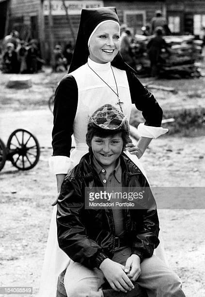 Italian actress Virna Lisi posing on the set of the film White Fang with her son Corrado Bad Mitterndorf 1973