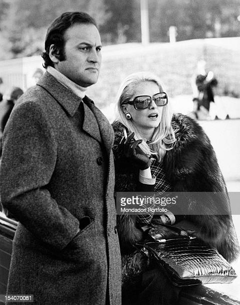 Italian actress Virna Lisi smoking with her husband Franco Pesci Cortina d'Ampezzo 1973