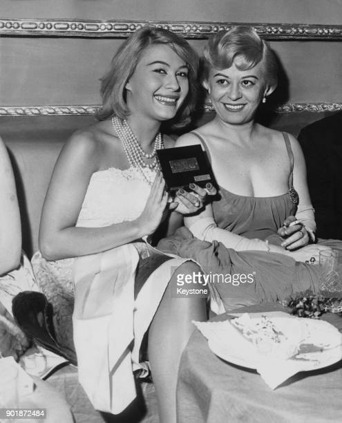 Italian actresses Franca Bettoia and Giulietta Masina with a Ciak d'oro award at the Lloyd Club in Naples Italy 25th February 1959