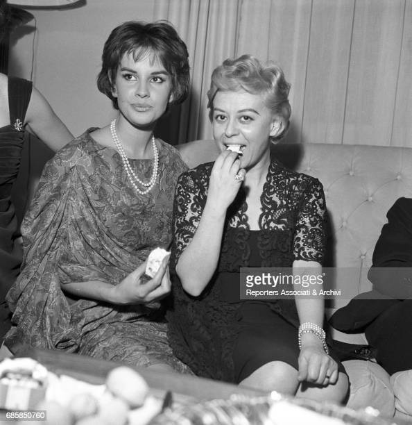 Italian actresses Giulietta Masina and Antonella Lualdi celebrating New Year's Eve in Fellini's house 31th December 1958