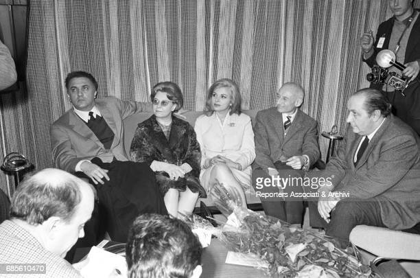 Italian actresses Giulietta Masina and Sandra Milo Italian director Federico Fellini and Greekborn Italian producer Moris Ergas leaving from...