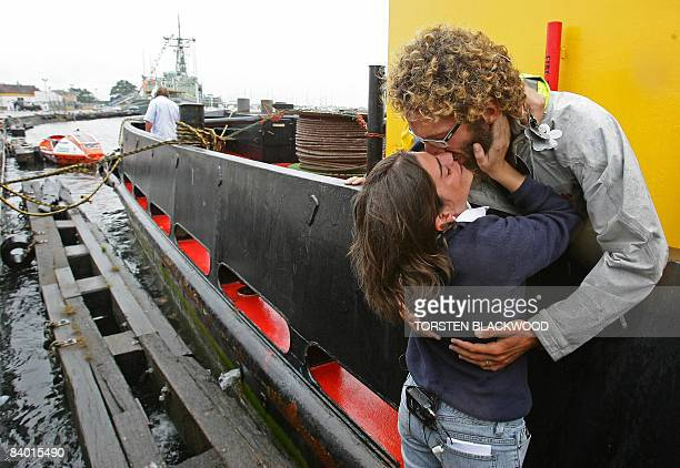 Italian adventurer Alex Bellini , who spent the past 10 months rowing solo across the Pacific Ocean from Peru, kisses his wife Francesca in Newcastle...