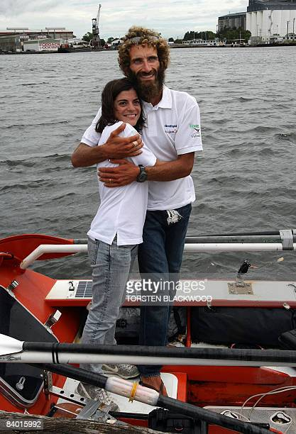 Italian adventurer Alex Bellini, who spent the past 10 months rowing solo across the Pacific Ocean from Peru, hugs his wife Francesca aboard his...