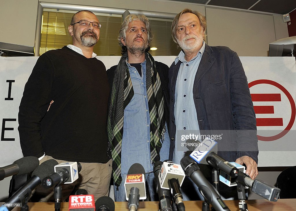 Italian aid workers Marco Garatti (L) and Matteo Dell'Aira (R) from the aid agency 'Emergency' pose with the founder of Italian medical organization 'Emergency', Gino Strada (C) following a press conference on April 23, 2010 in Milan. Three Italian charity workers freed on April 18 more than a week after being arrested for allegedly plotting to kill an Afghan official said investigations had proved them innocent. Matteo Dell'Aria, Marco Garatti and Matteo Pagani work for the Milan-based medical charity Emergency and were arrested on April 10 near the charity's hospital in Lashkar Gah, capital of restive Helmand province.